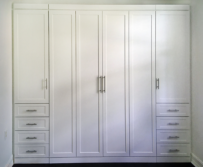 Queen sized Bi-fold murphy bed with a wardrobe storage and four drawers on each side, in white.