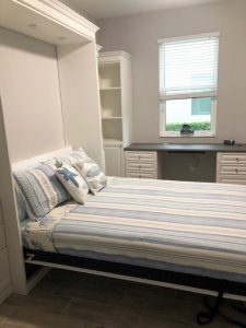 Miller's Murphy Bed & Home Office: bed folded down with flanking bookshelf cabinets